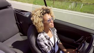 Young Black Sexy Lady Driving The Car