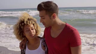 Young Mixed-Race Couple On The Beach