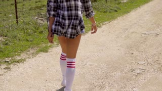 Young Sexy Woman Walking On The Road.