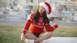 Young Smiling Beautiful Girl in Santa Hat