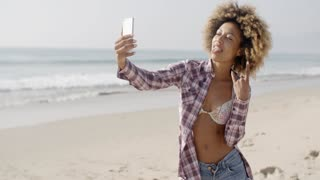 Young Woman Doing Selfie On The Beach