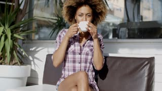 Young Woman Drinking Coffe Outdoors