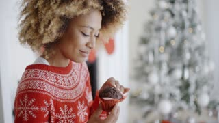 Young woman enjoying a Christmas treat