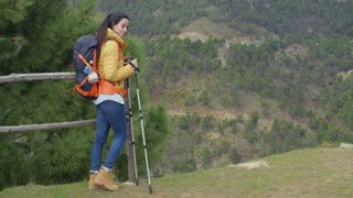 Young woman hiking on a mountain plateau