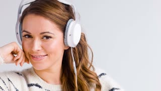 Young Woman Listen To The Music With Her Headphones