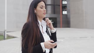 Young woman listening to a mobile call