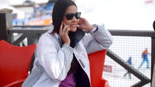 Young woman relaxing at an alpine ski resort