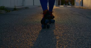 Young Woman Riding on Roller Skates