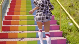 Young Woman Running Up The Stairs.