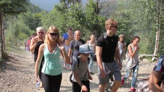 A group of tourists students walk on mountains - Carpathians green summer
