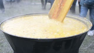 A large cauldron of porridge in the refugee camp