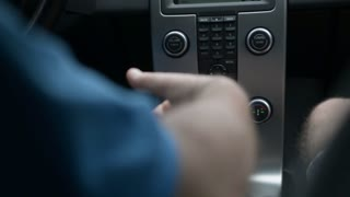 A man drives Volvo, turn the steering wheel of a vehicle