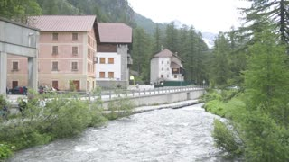 Alpine river flows along a small town