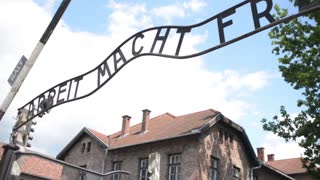 Arbeit Macht Frei - Auschwitz Concentration Camp - barracks and barbed wire