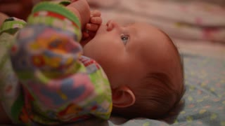 Baby is teething - crying and puts in mouth her fist