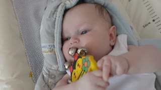 Baby is teething - puts in mouth a rattle