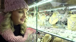 Beautiful Blonde young Woman shopping on Jewellery Market