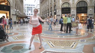 Beautiful girl dancing salsa in the gallery in the centr of Milan