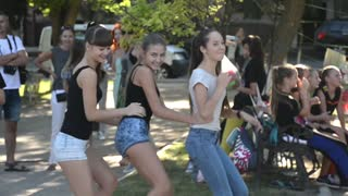 Beautiful girls are dancing in the street