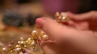 Bijouterie Market -Master takes  jewelry in hands