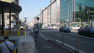 Bike Path and cyclists on the street of Milan