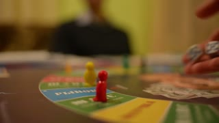 Board Game Cash Flow - player makes his move