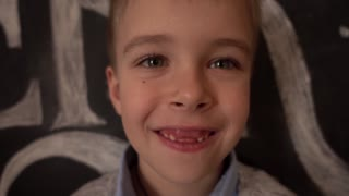 Boy with no front baby Teeth smiling