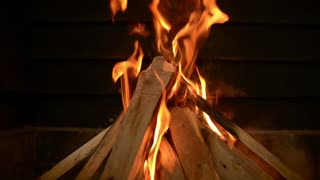 Burning wood in a fireplace - winter home comfort