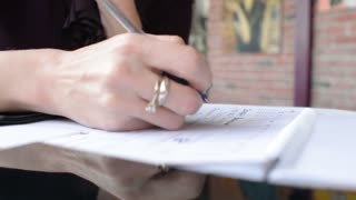 Business Woman Hand Write Notes In Notebook and Mobile Sell Phone
