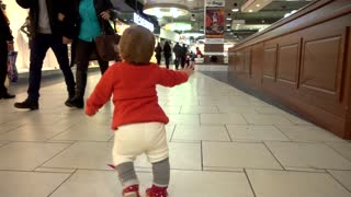 Child Baby run and fall down through the Mall and Clothes Store