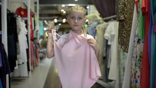 Child Girl Get Shopping at the Clothes Store - posing in front of mirror