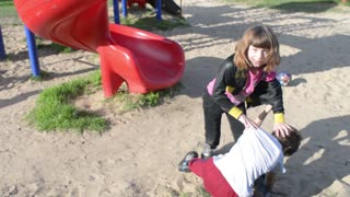 Children, boys and girls are fighting for fun on the playground