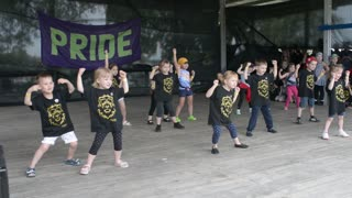 children dancing modern sports dances on stage