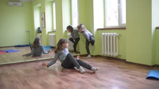Children dancing, playing and fooling around in the gym