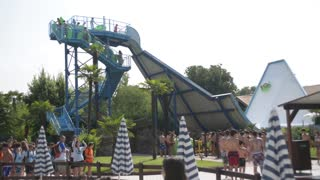 Children go to the attraction in the water park