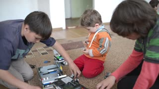 Children playing with Lego on the floor in the room