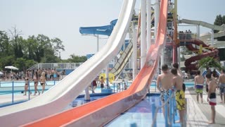 Children ride on the big slides in the water park