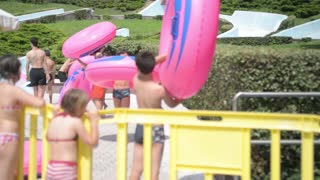 Children run with the rubber ring in the water park