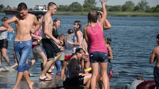 Children teenagers poured water on each other in the hot summer - wet body