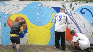 Children with physical development disorders paint the wall art therapy