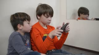 Children with their gajets and mobile phone in school