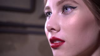 Close-up of lips with red lipstick and seductively Slightly white teeth
