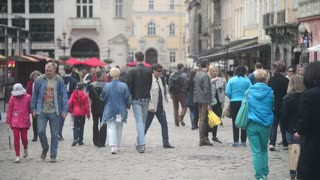 Croud of tourists walking through the old streets of Lvov Lviv - spring day