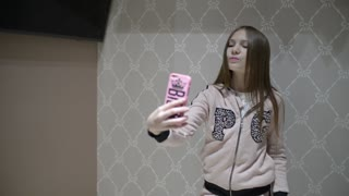 Cute Girl Posing Taking Selfie Shots In New Clothes Store