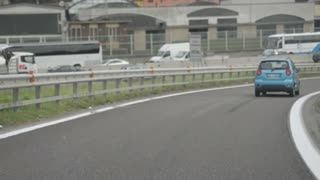 Driving car in the autostrada of suburb of Milan. Italy
