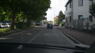Driving car in the street of suburb of Milan. Italy