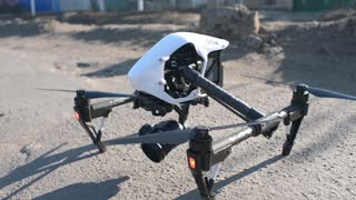 drone takes off from the ground - four propeller spinning creating lift