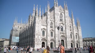 Duomo in Milan - the crowds of tourists walk on the square