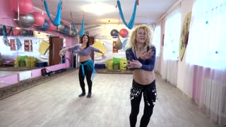 Eastern Belly Dance Open training of middle-aged women dancing seductive