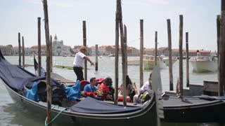 Embankment and pier in Venice and parked gondolas
